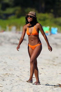 Gabrielle Union – bikini beach candids in Miami, December 22, 2011